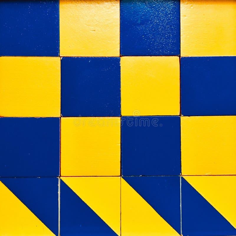 Μπλε και κίτρινο σχέδιο τετραγώνων στοκ εικόνα με δικαίωμα ελεύθερης χρήσης