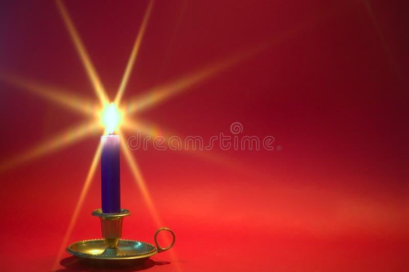 μπλε κόκκινο κεριών ανασκόπησης στοκ φωτογραφία