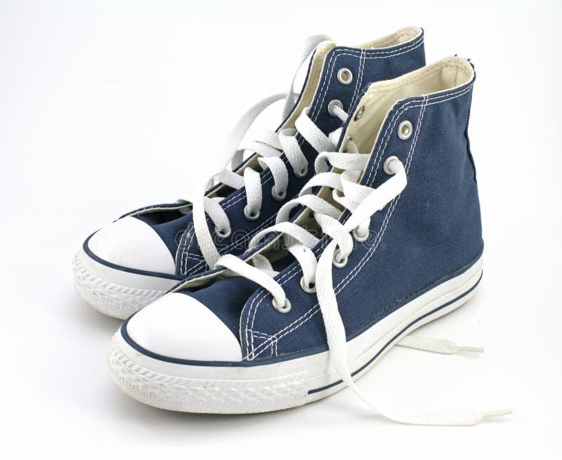 μπλε πάνινα παπούτσια στοκ εικόνα
