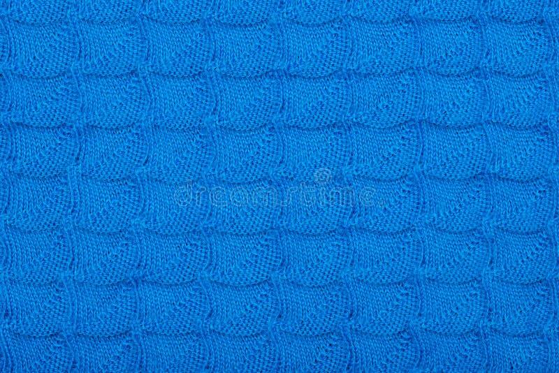 Μπλε πλεκτό ύφασμα με το σχέδιο για το σχέδιο στοκ εικόνες