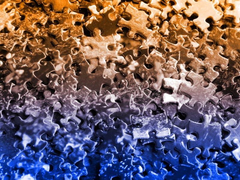 μπλε πορτοκαλής γρίφος κομματιών στοκ εικόνα