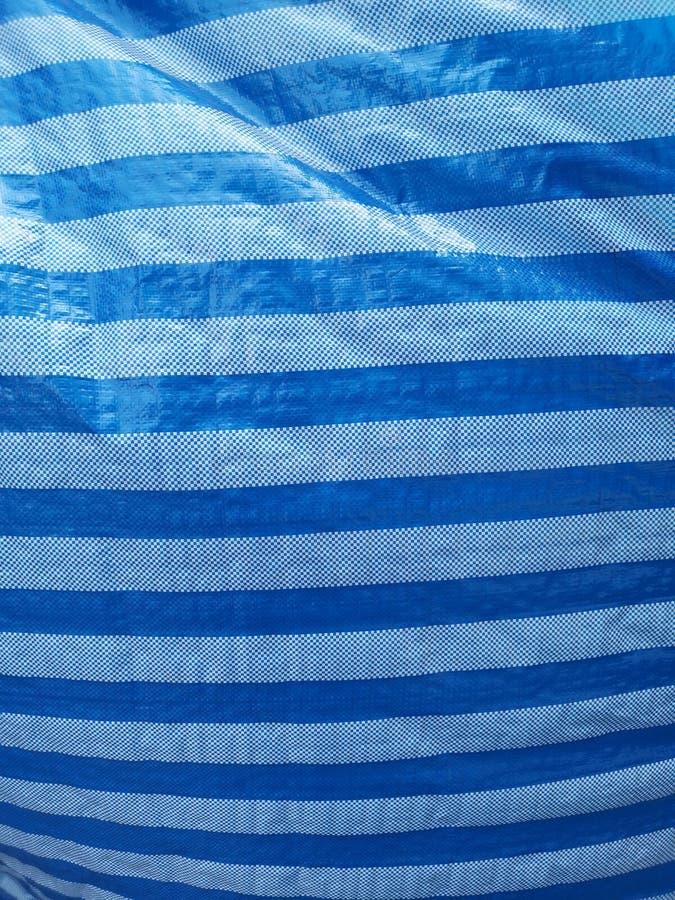 Μπλε ριγωτό πλαστικό υπόβαθρο φύλλων στοκ εικόνες με δικαίωμα ελεύθερης χρήσης