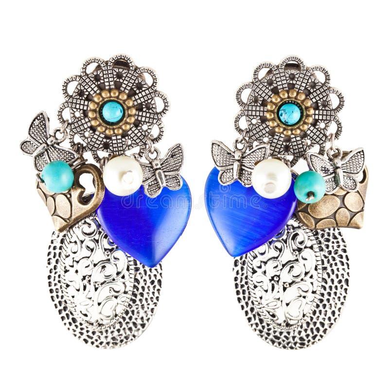 μπλε σπιτικές διαμορφωμένες πέτρες καρδιών σκουλαρικιών στοκ εικόνα