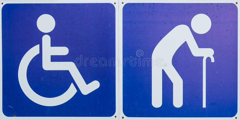 Μπλε σύμβολο αναπηρίας, εκτός λειτουργίας σημάδι και παλαιότερο σημάδι στοκ φωτογραφίες με δικαίωμα ελεύθερης χρήσης