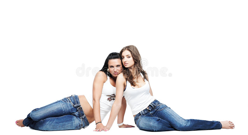 μπλε τζιν δύο φίλων που φορούν στοκ εικόνα με δικαίωμα ελεύθερης χρήσης