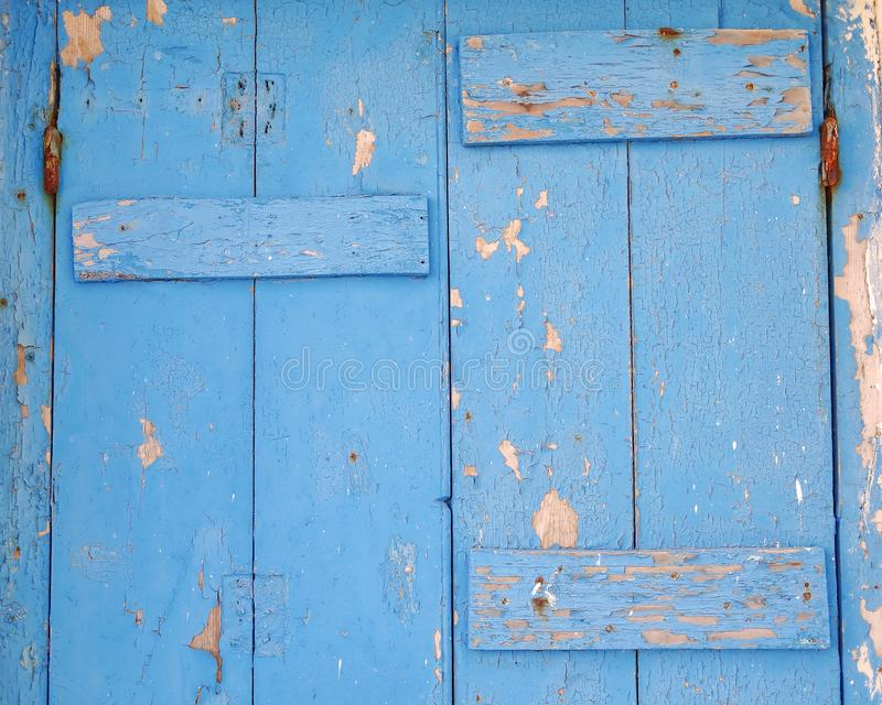 Μπλε χρωματισμένη ξύλινη κινηματογράφηση σε πρώτο πλάνο επιφάνειας πορτών στοκ φωτογραφία