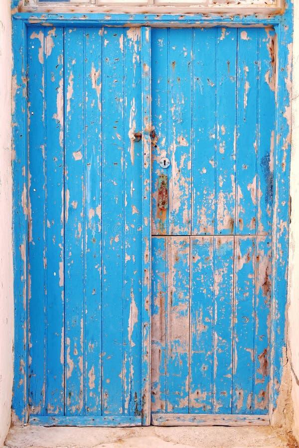 Μπλε χρωματισμένη ξύλινη κινηματογράφηση σε πρώτο πλάνο επιφάνειας και πλαισίων πορτών στοκ εικόνα με δικαίωμα ελεύθερης χρήσης