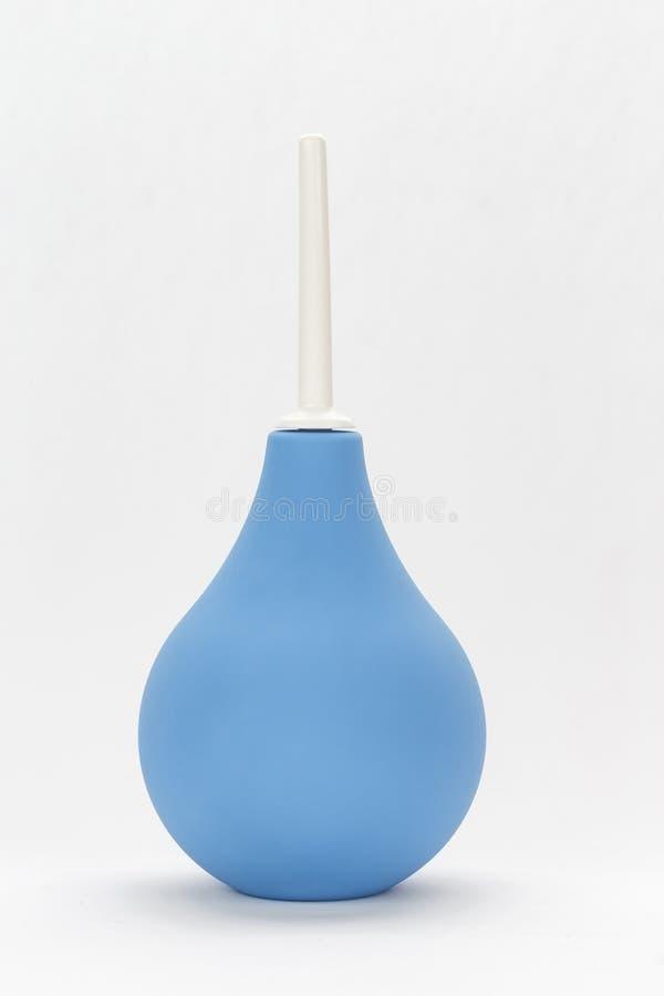 Μπλε enema σε ένα άσπρο υπόβαθρο στοκ φωτογραφίες
