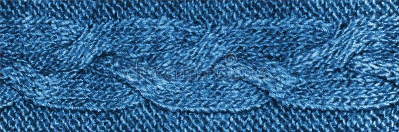 Μπλε knitwear ύφασμα με την πλεξίδα, πλεκτή σύσταση μαλλιού του Τζέρσεϋ στοκ εικόνα