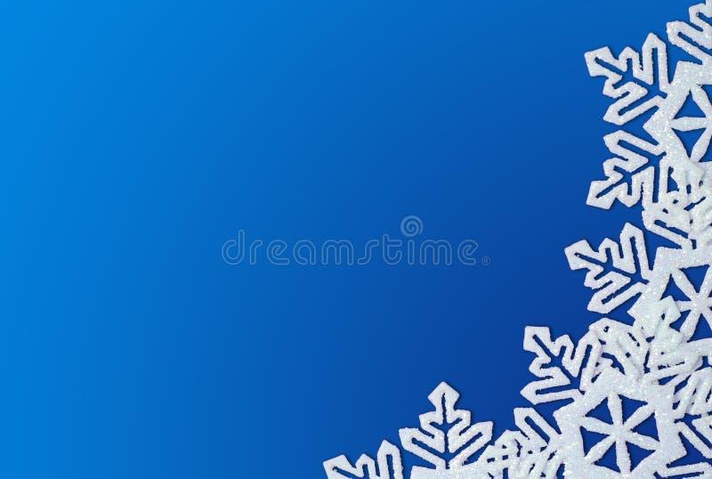 μπλε snowflakes ανασκόπησης διανυσματική απεικόνιση