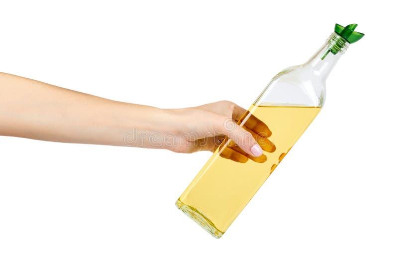 Μπουκάλι γυαλιού ελαιολάδου με το χέρι που απομονώνεται στο άσπρο υπόβαθρο στοκ φωτογραφία