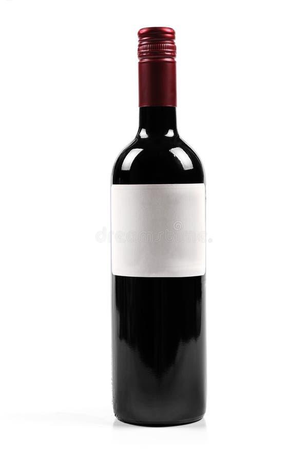 Μπουκάλι κόκκινου κρασιού που απομονώνεται στο λευκό στοκ εικόνες
