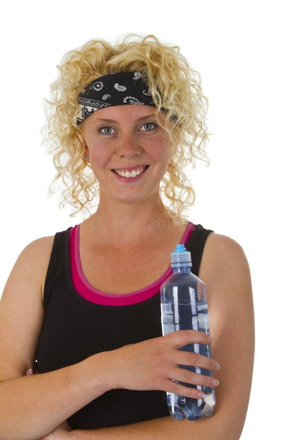 Μπουκάλι νερό εκμετάλλευσης γυναικών στοκ εικόνες
