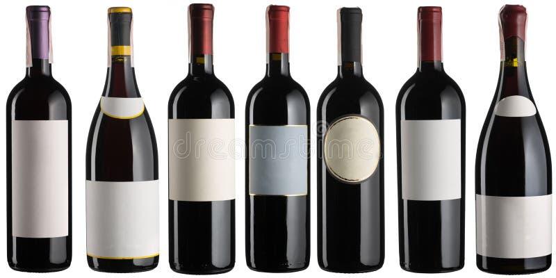 Μπουκάλια κόκκινου κρασιού καθορισμένα στοκ εικόνες