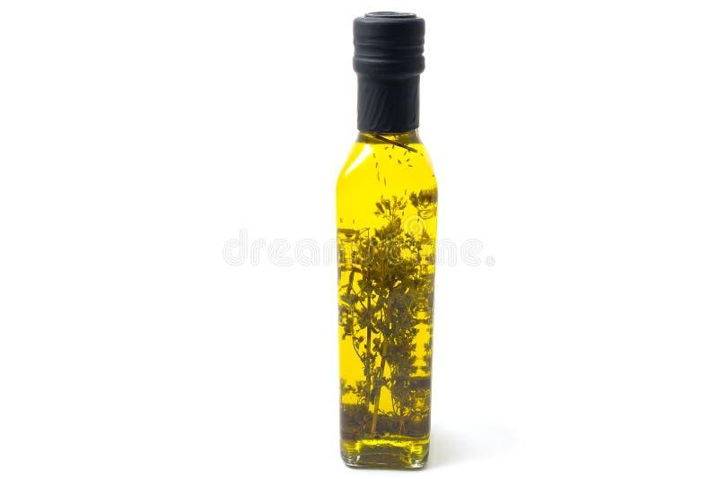 Μπουκάλια του πρόσθετου παρθένου ελαιολάδου με oregano που απομονώνεται στο λευκό στοκ φωτογραφία με δικαίωμα ελεύθερης χρήσης