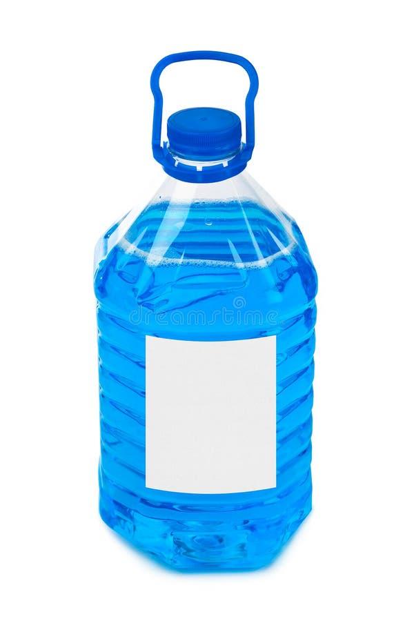 Μπουκάλι με την μπλε υγρή και κενή ετικέτα στοκ εικόνες