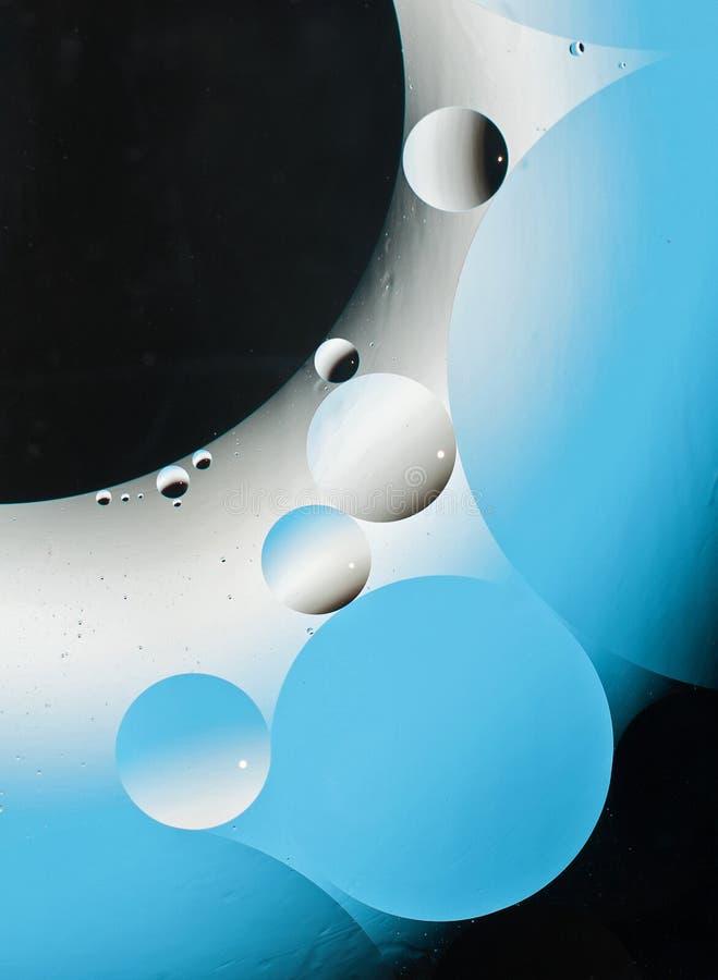 Μπλε έλαιο και νερό στοκ εικόνες