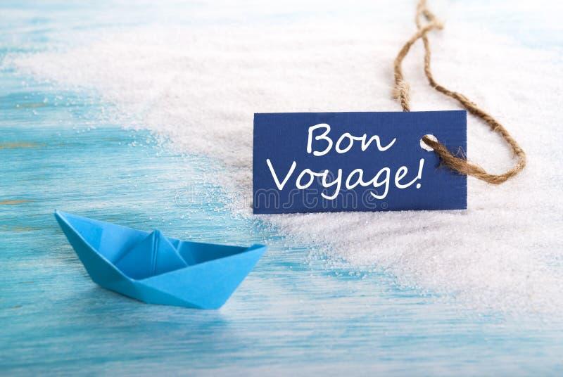 Μπλε ετικέτα με το ταξίδι Bon στοκ φωτογραφία με δικαίωμα ελεύθερης χρήσης