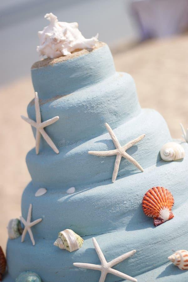 Μπλε κέικ άμμου με το αστέρι στοκ εικόνες