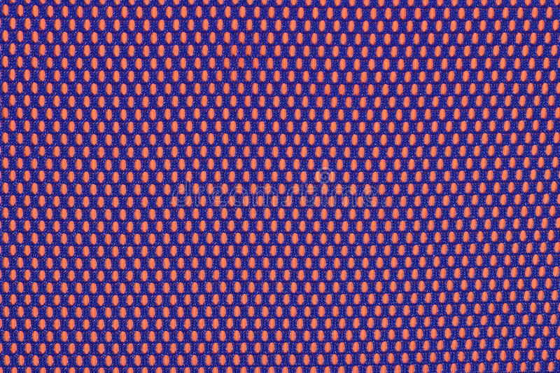 Μπλε μη υφανθε'ν ύφασμα σε ένα πορτοκάλι στοκ εικόνες με δικαίωμα ελεύθερης χρήσης