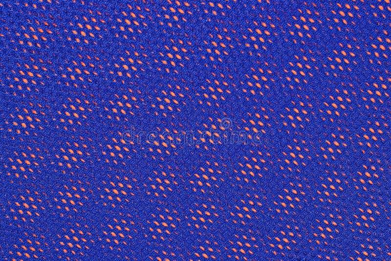 Μπλε μη υφανθε'ν ύφασμα σε ένα πορτοκάλι στοκ εικόνα με δικαίωμα ελεύθερης χρήσης