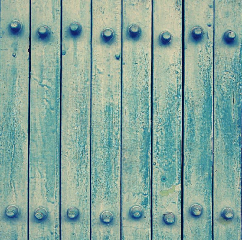 Μπλε πόρτα μετάλλων (εκλεκτής ποιότητας ύφος και θόρυβος επίδρασης προστιθέμενοι) στοκ φωτογραφίες