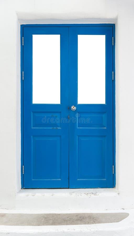 Μπλε πόρτα στον άσπρο τοίχο στοκ εικόνες