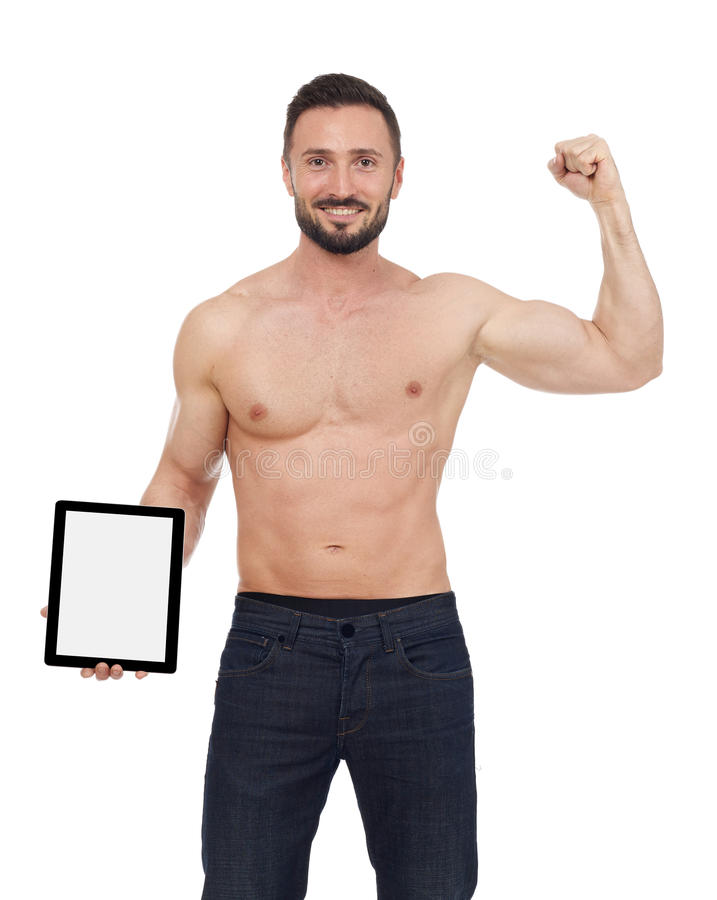 Μυϊκό άτομο με την ψηφιακή ταμπλέτα στοκ φωτογραφία