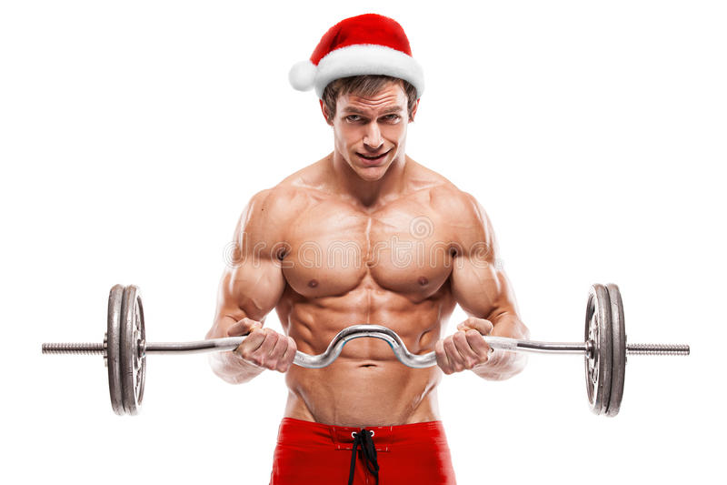 Μυϊκό bodybuilder Άγιος Βασίλης που κάνει τις ασκήσεις με τους αλτήρες στοκ εικόνες με δικαίωμα ελεύθερης χρήσης