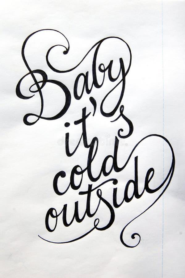 Μωρό αυτό κρύο ` s έξω από το καλλιγραφικό υπόβαθρο στοκ φωτογραφίες