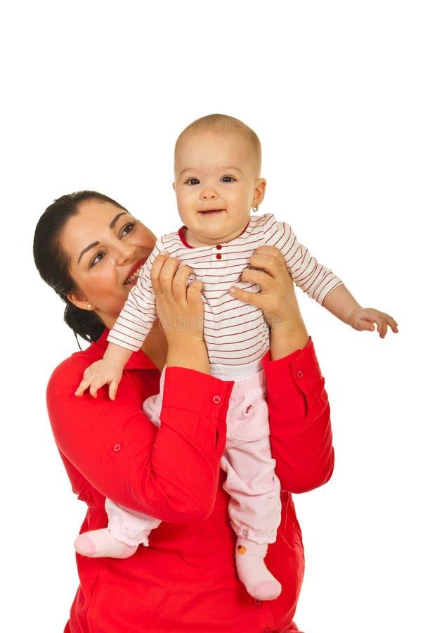 μωρό ευτυχές το χαμόγελο μητέρων της στοκ φωτογραφία με δικαίωμα ελεύθερης χρήσης