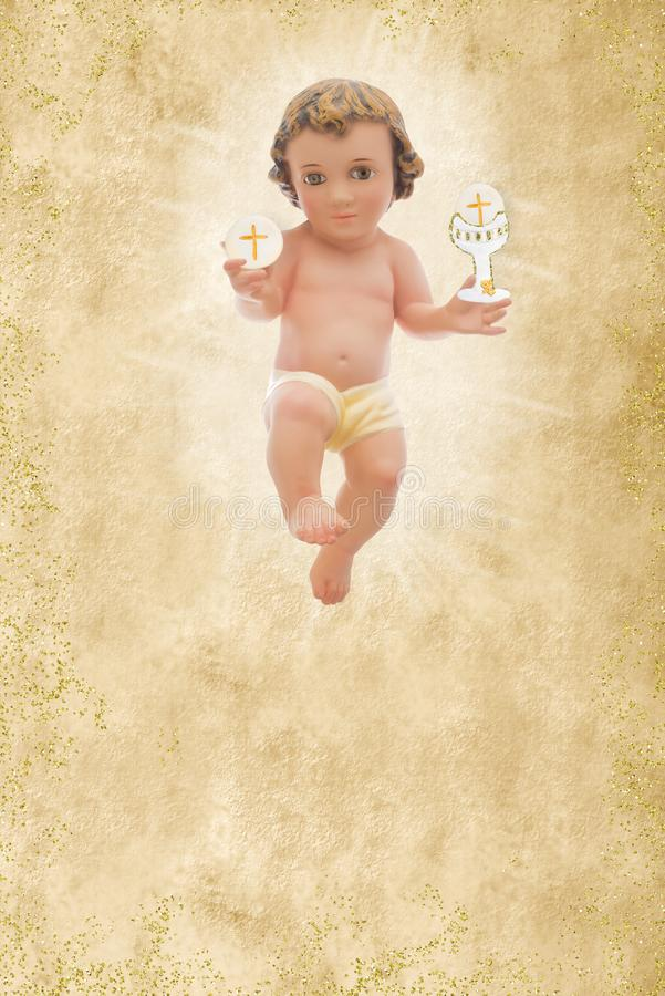 Μωρό Ιησούς, πρώτη ιερή κοινωνία, κάθετο υπόβαθρο στοκ εικόνες