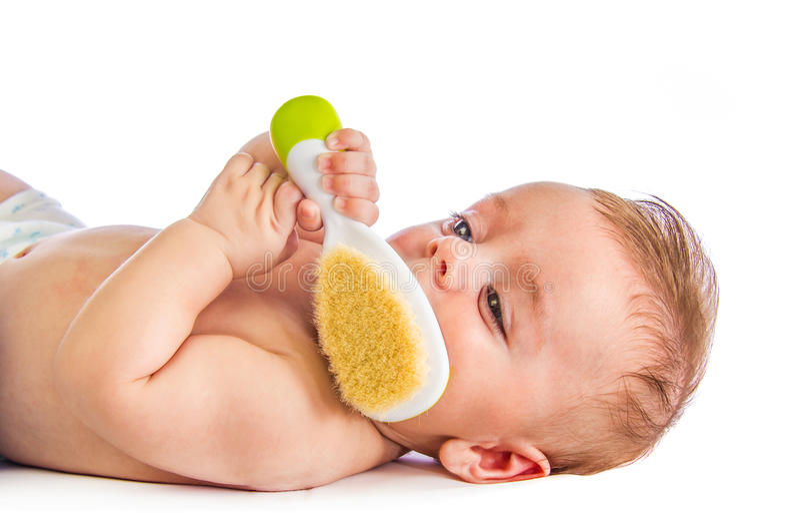 Μωρό με τη βούρτσα γηα τα μαλλιά στοκ φωτογραφία με δικαίωμα ελεύθερης χρήσης