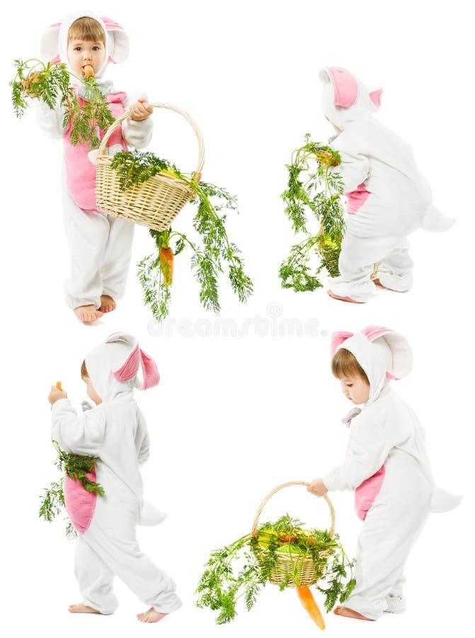 Μωρό στο κοστούμι λαγουδάκι Πάσχας με το καλάθι καρότων, Κ στοκ εικόνες