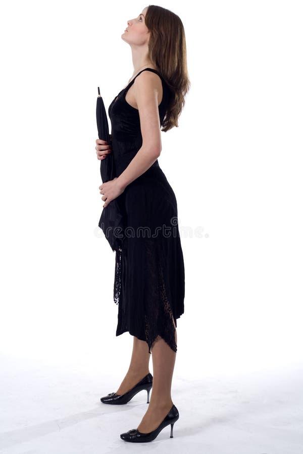 Μόνιμη κυρία με την ομπρέλα στοκ εικόνες