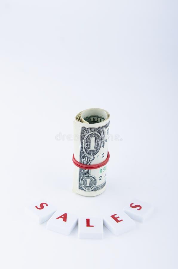 Μόνιμοι κυλημένοι λογαριασμοί δολαρίων στοκ φωτογραφίες