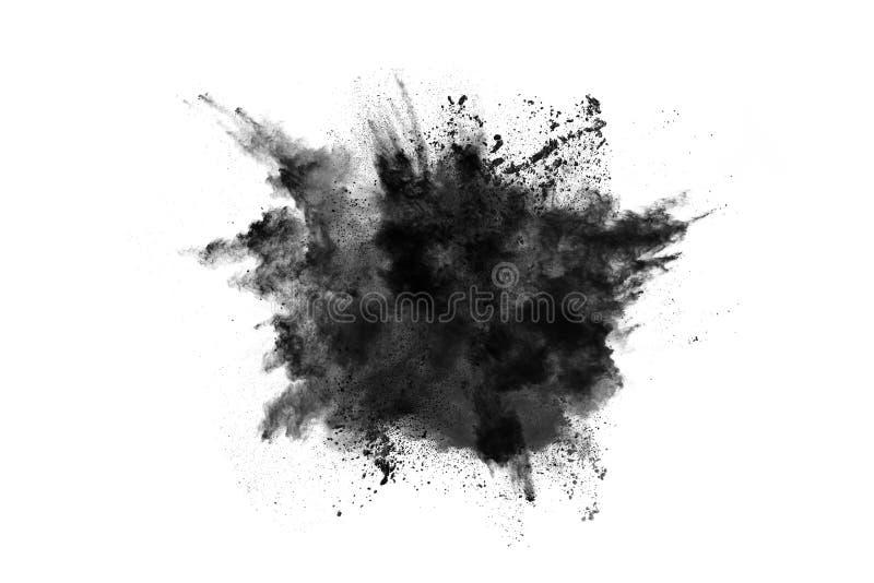 Μόρια της έκρηξης σκονών ξυλάνθρακα στο άσπρο υπόβαθρο στοκ εικόνα