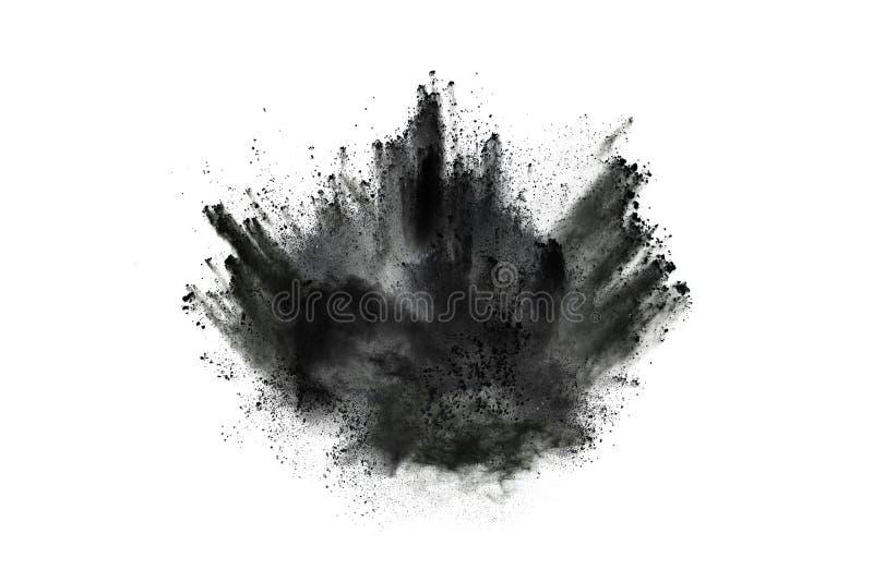 Μόρια της έκρηξης σκονών ξυλάνθρακα στο άσπρο υπόβαθρο στοκ φωτογραφία