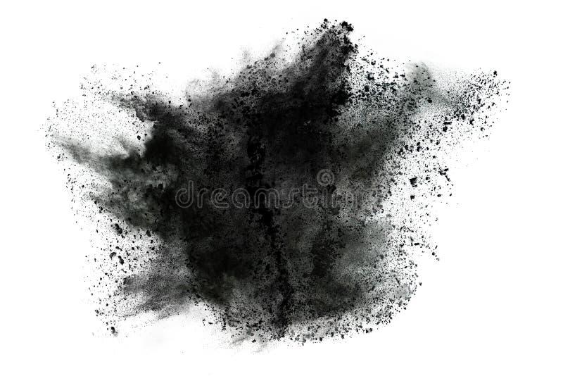 Μόρια της έκρηξης σκονών ξυλάνθρακα στο άσπρο υπόβαθρο στοκ εικόνες