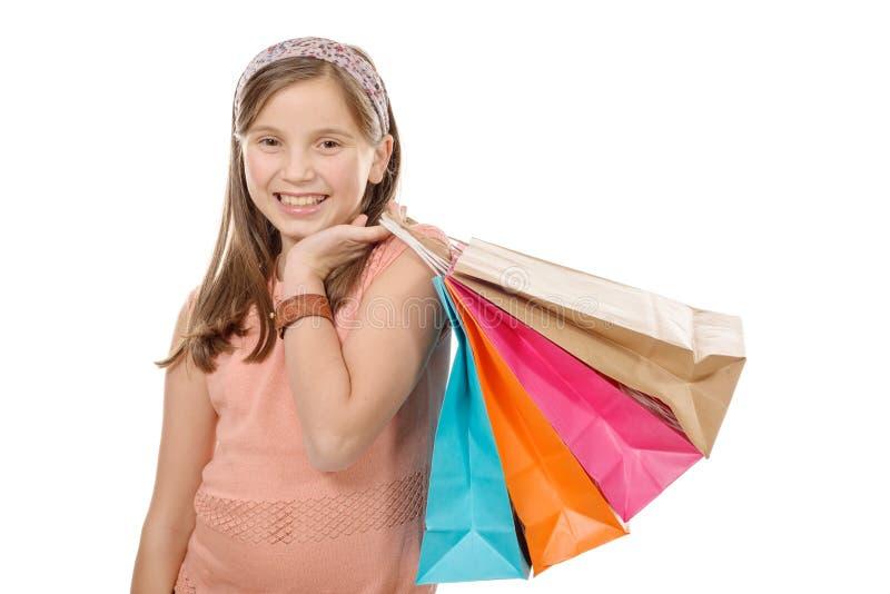 Νέα λαβή εφήβων με την τσάντα αγορών στοκ εικόνα με δικαίωμα ελεύθερης χρήσης