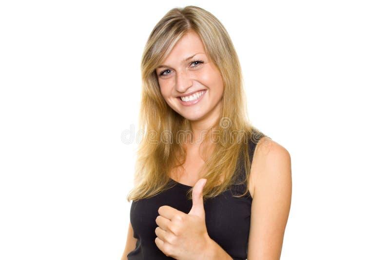 Νέα γυναίκα. Αντίχειρας επάνω στοκ εικόνα με δικαίωμα ελεύθερης χρήσης
