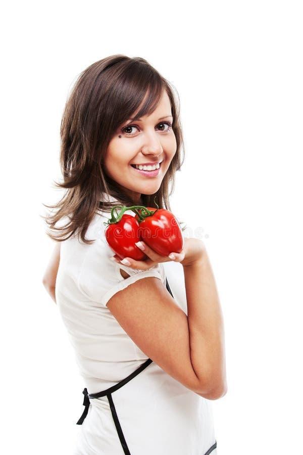 Νέα γυναίκα με τις ντομάτες στοκ φωτογραφίες