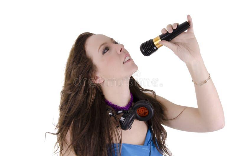 Νέα γυναίκα με το μικρόφωνο στοκ εικόνες με δικαίωμα ελεύθερης χρήσης