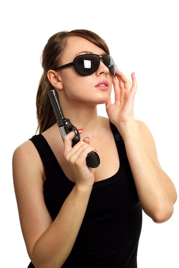 Νέα γυναίκα με το πυροβόλο όπλο στοκ εικόνα