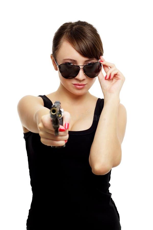 Νέα γυναίκα με το πυροβόλο όπλο στοκ εικόνες