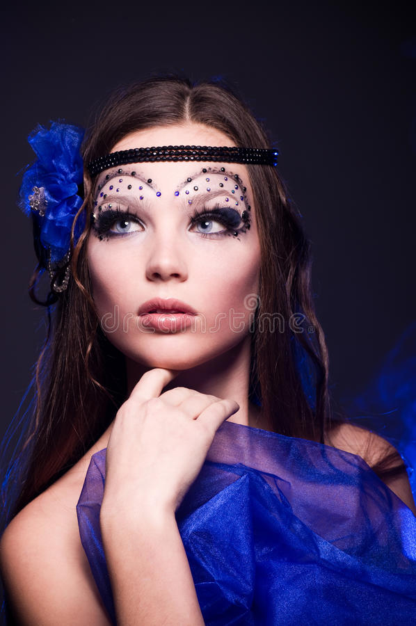 Νέα γυναίκα με το makeup στοκ εικόνα με δικαίωμα ελεύθερης χρήσης