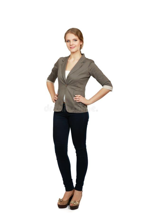 Νέα γυναίκα που στέκεται στο πλήρες μήκος που απομονώνεται επάνω στοκ φωτογραφίες με δικαίωμα ελεύθερης χρήσης