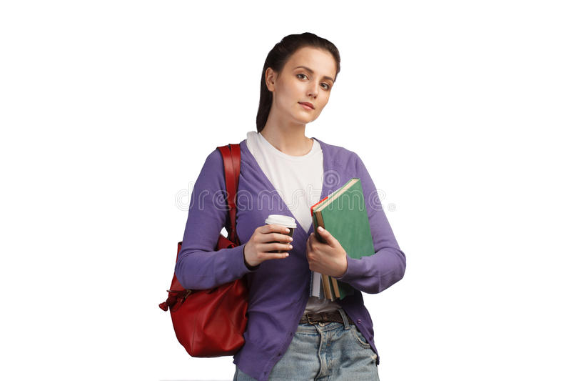 Νέα γυναίκα σπουδαστής με τα βιβλία και το σακίδιο πλάτης στοκ εικόνες