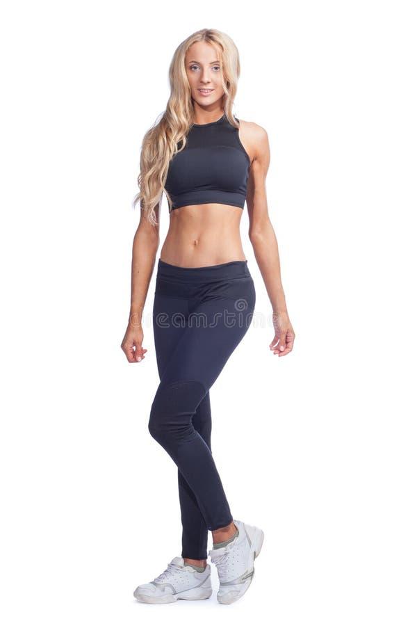 Νέα γυναίκα στο αθλητικό κοστούμι στοκ εικόνες με δικαίωμα ελεύθερης χρήσης