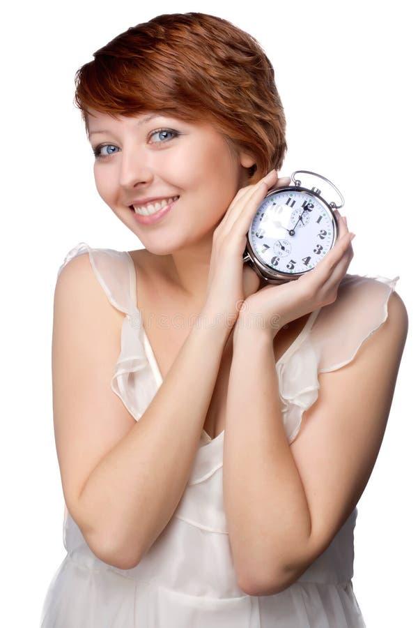 Νέα γυναίκα στο πρωί με το ρολόι στοκ εικόνες
